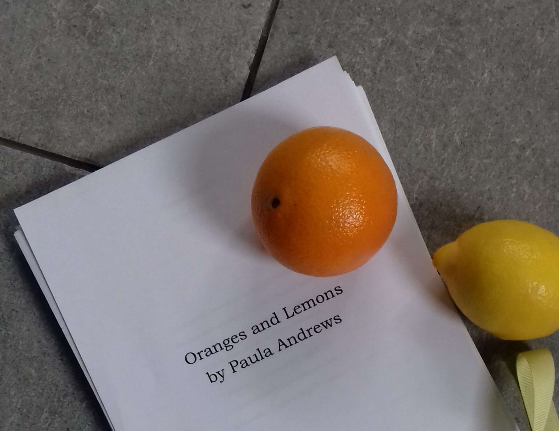 image of manuscript for Oranges and Lemons with an orange and a lemon on top
