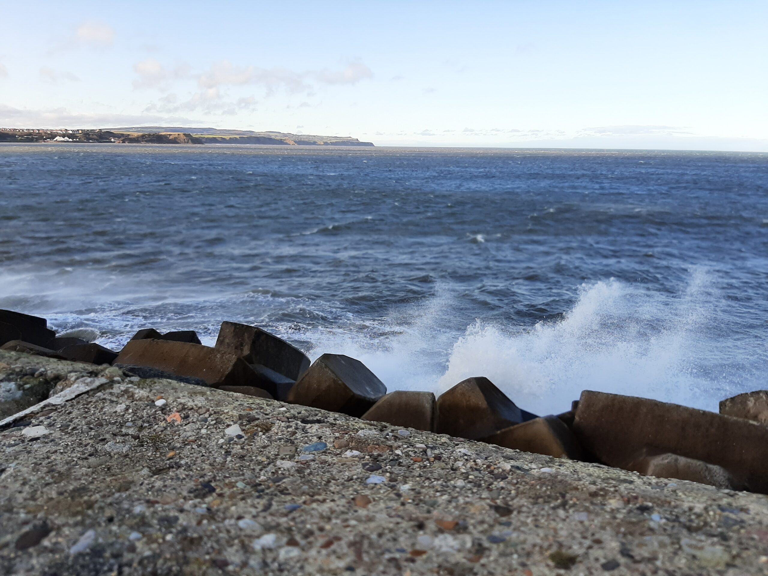 Waves crashing against seawall between South and North Bay Scarborough