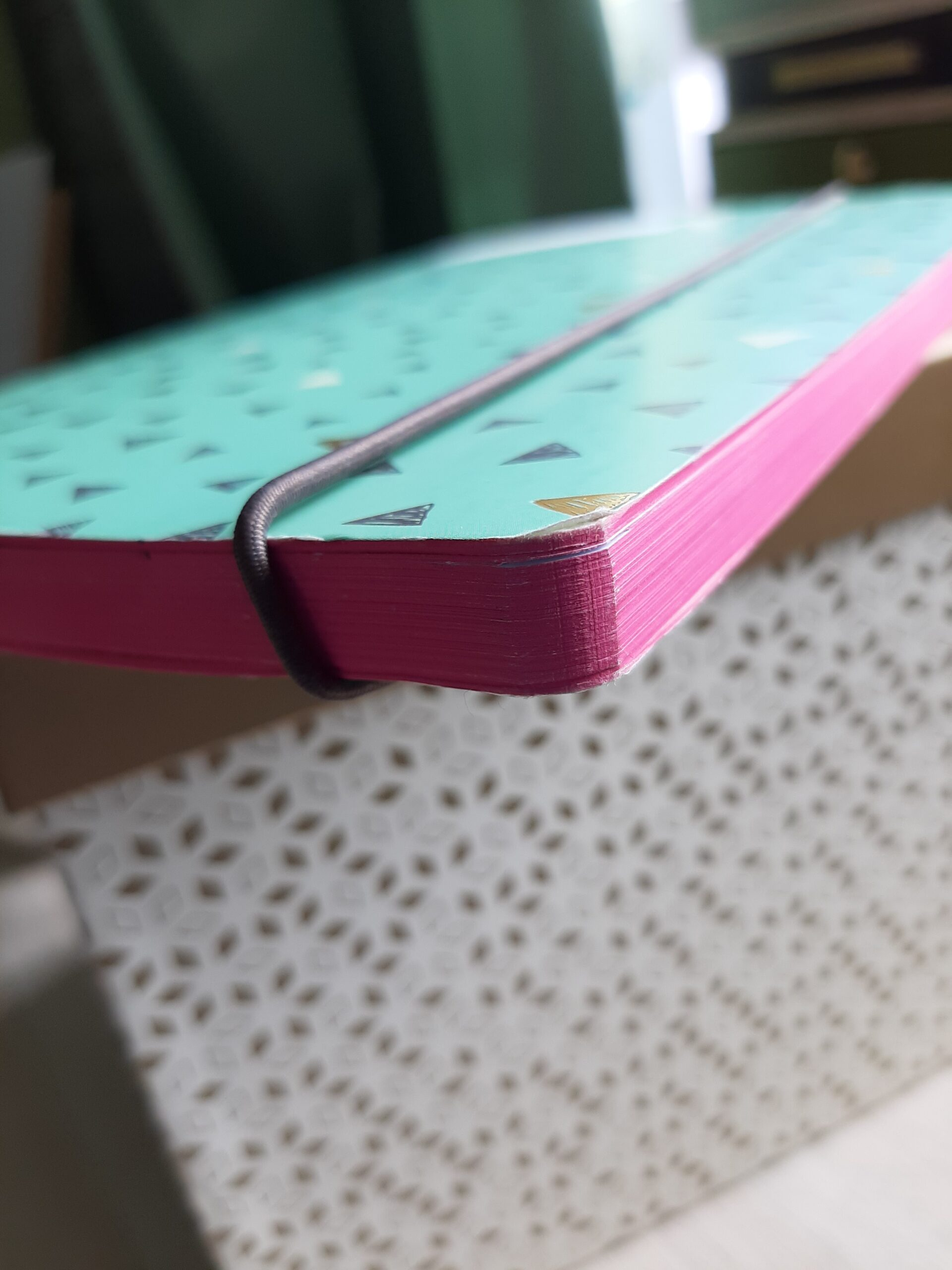 Notebook with pink page edges