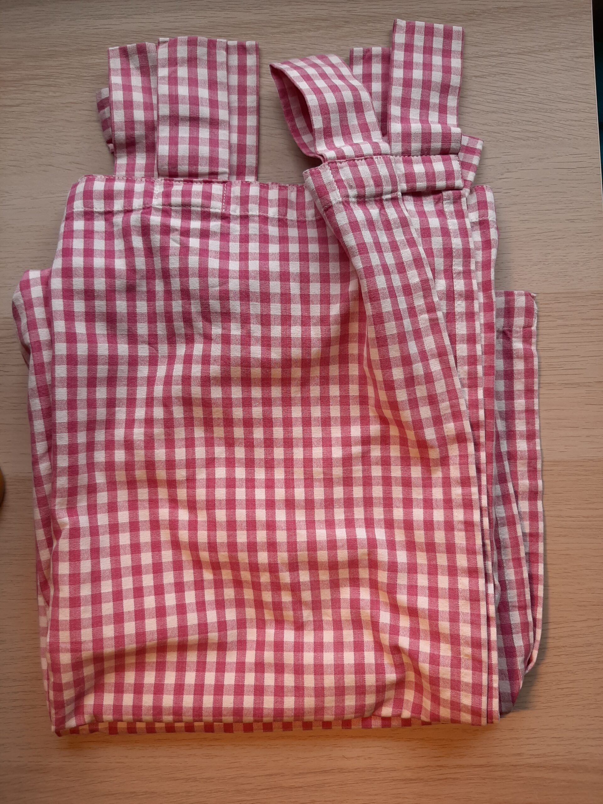 folded red gingham tab-top curtain