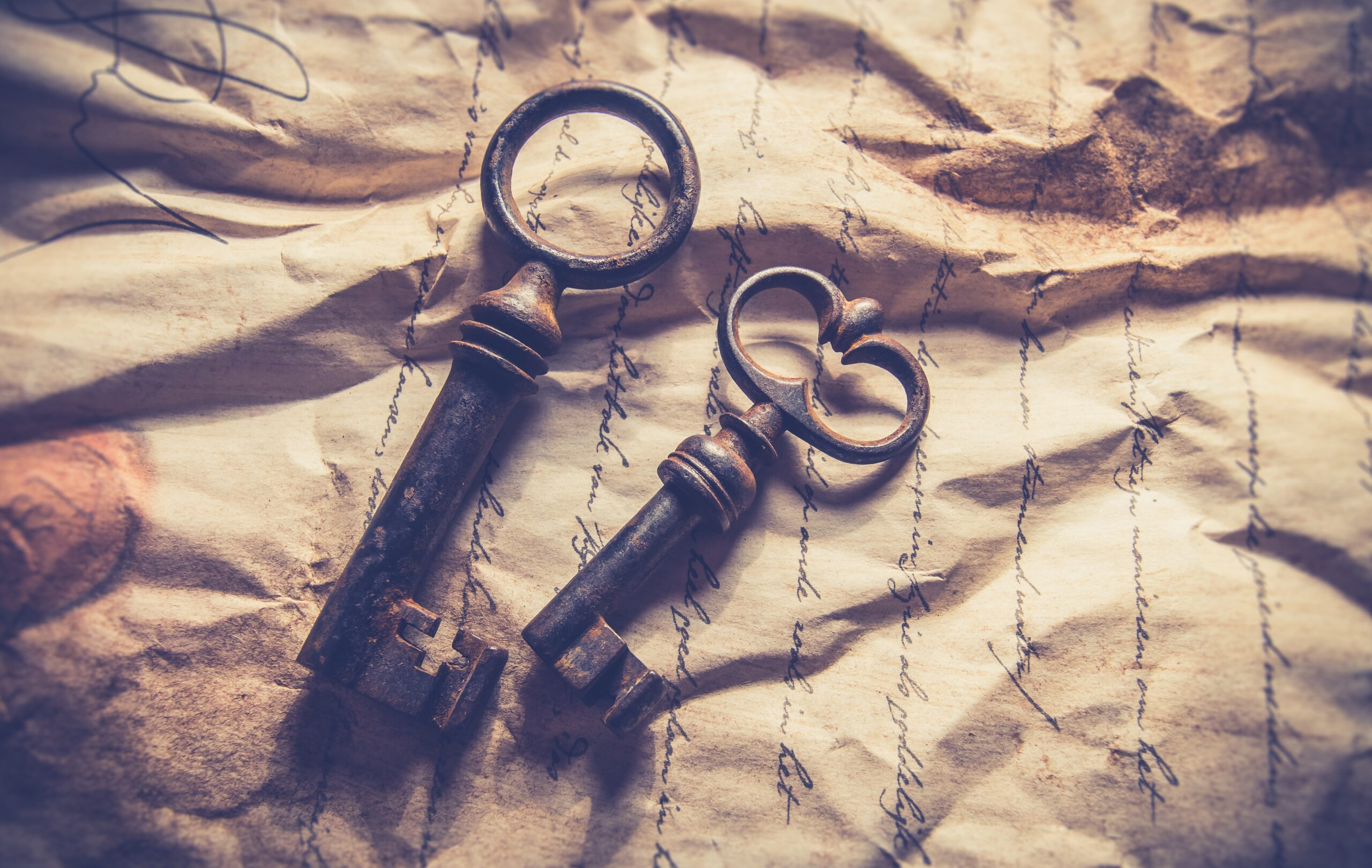 antique keys on a sepia coloured handwritten letter
