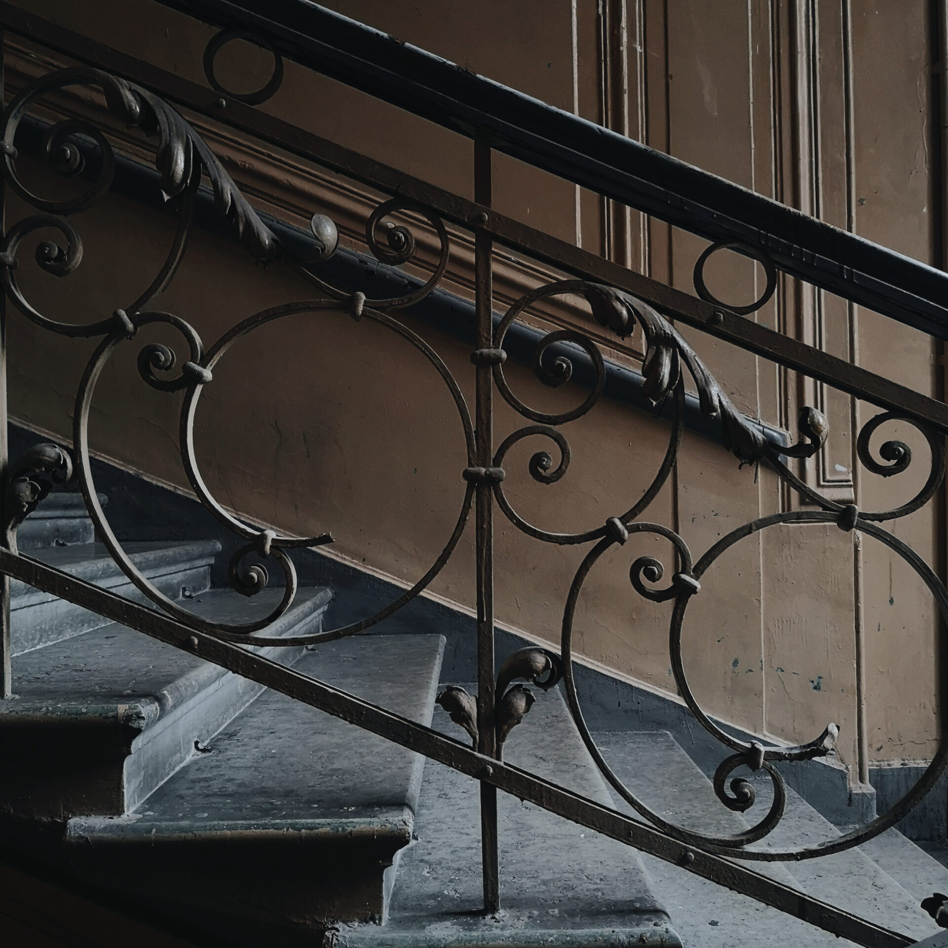 old stone steps with iron railing